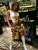 Deep Throat Energy Drink girl at the International Lingerie Show holding the Deep Throat Guitar Hero guitar